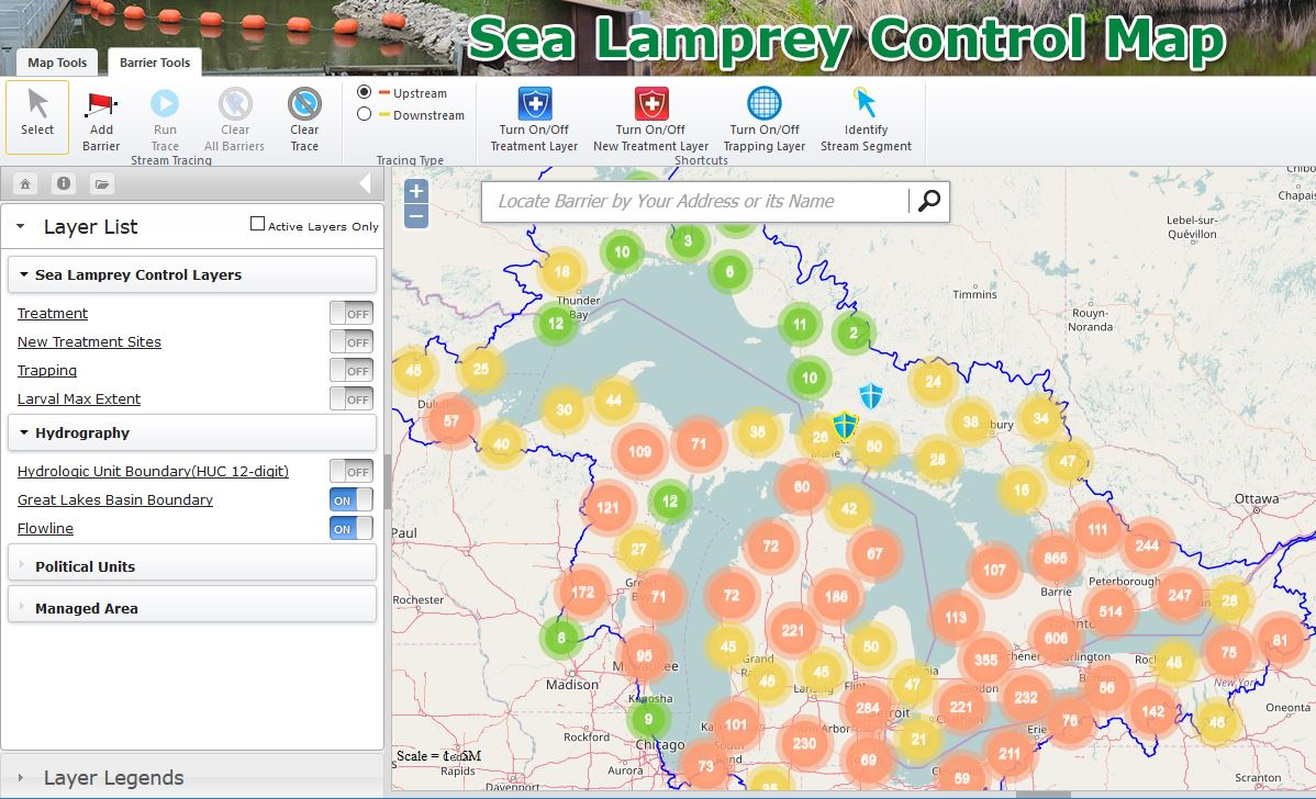 Screen shot from the Sea Lamprey Barrier Mapping Tool.  Shows a map with clusters of barriers in the great lakes basin.